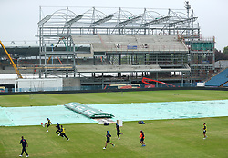England play football in front of the new stand under construction at Headingley during a nets session at Headingley, Leeds.