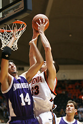VIrginia's Jason Cain (33) grabs one of his seven rebounds against Northwestern.  UVA won the game 72-57, winning a point for the ACC in the ACC/BigTen Challenge...The Virginia Cavaliers Men's Basketball team defeated the Northwestern Wildcats 72-57 in the ACC/BigTen Challenge at University Hall in Charlottesville, VA on November 30, 2005..