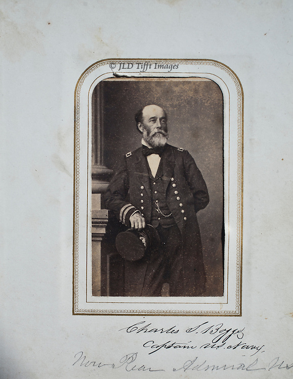 Portrait from a carte de visite.  Dtanding, leaning on a studio pillar, hat in hand.