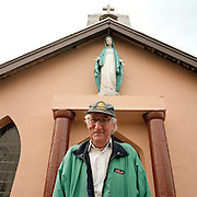 A local man stands beneath a statue of the Virgin Mary in Ringaskiddy, County Cork, Ireland, near the local Pfizer factory that manufactures Viagra...