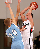 Linn-Mar's Matt Bohannon (23) looks for a teammate to pass the ball to as Jefferson's Cole Kramer (10) and Taylor Olson (23) pressure him during the first half of their game at Linn-Mar High School in Marion on Tuesday February 10, 2009. Linn-Mar defeated Jefferson 62-56.