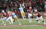 PALO ALTO, CA - SEPTEMBER 23:  K.J. Costello #3 of the Stanford Cardinal attempts a pass to Cameron Scarlett #22 during an NCAA Pac-12 football game against the UCLS Bruins on September 23, 2017 at Stanford Stadium in Palo Alto, California.  Pressuring Costello is Keisan Lucier-South #11 of UCLA, at right is Nate Herbig #63 of Stanford.  (Photo by David Madison/Getty Images)