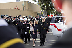 December 24, 2017 - San Diego, California, U.S - Wife Ashley Iverson and daughter Evie are escorted by CAL FIRE at the celebration of life of Cory Iverson who was killed battling the Thomas Fire at the Rock Church in San Diego on Saturday December 24, 2017. (Credit Image: © Kevin Warn via ZUMA Wire)