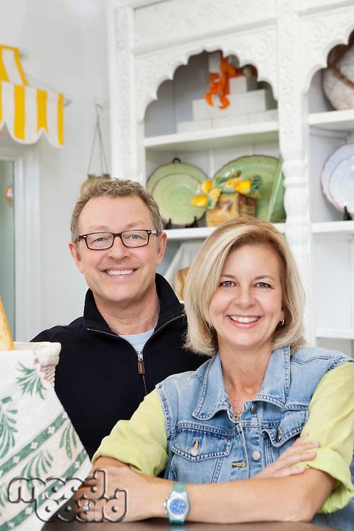 Portrait of mature couple in cake shop