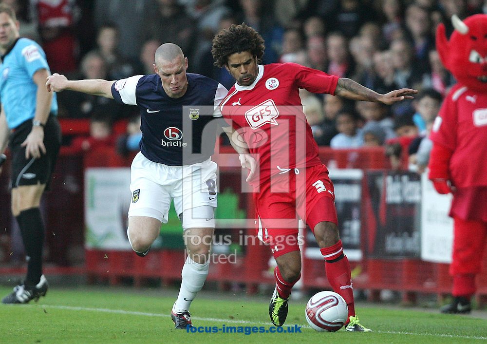 Picture by Paul Terry/Focus Images Ltd. 07545642257.19/11/11.Dean Howell of Crawley and James Constable of Oxford during the Npower League 2 match at Broadwood stadium, Crawley, West Sussex.