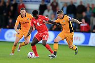 Kabongo Tshimanga of Milton Keynes Dons &copy; holds off Scot Bennett of Newport county &reg;. EFL cup, 1st round match, Newport county v Milton Keynes Dons at Rodney Parade in Newport, South Wales on Tuesday 9th August 2016.<br /> pic by Andrew Orchard, Andrew Orchard sports photography.