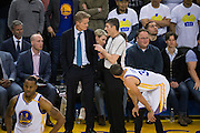 Golden State Warriors head coach Steve Kerr talks with a referee during a game against the LA Clippers at Oracle Arena in Oakland, Calif., on February 23, 2017. (Stan Olszewski/Special to S.F. Examiner)