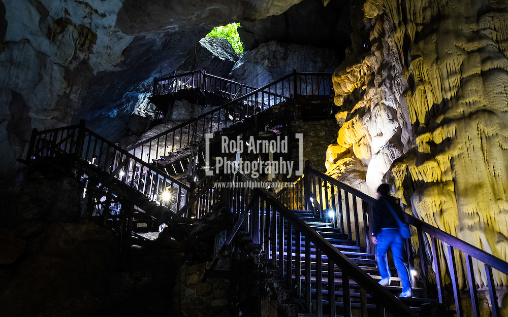 A woman walking up the stairway to the entrance/exit of Paradise Cave in Phong Nha National Park, Vietnam