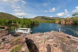 Passengers from charter boat MV Odyssey in a remote gorge on the Kimberley coast.