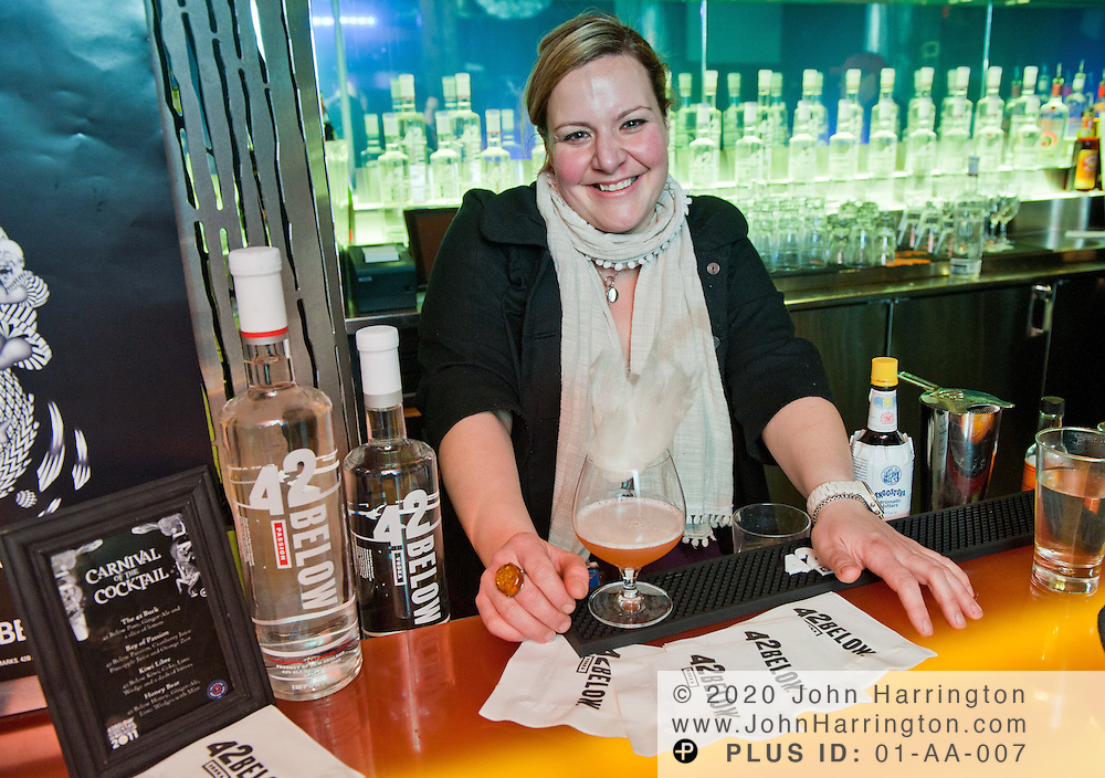 """Gina Chersevani, finalist in the East Coast regional competition of the 2011 42BELOW Cocktail World Cup mixes her winning drink """"Up in Smoke"""". Chersevani, representing PS 7's in Washington, D.C. will join JP Caceres of AGAINN in the national round of competition in New York City on February 13th. In its seventh year, the 42BELOW Cocktail World Cup """"Carnival of the Cocktail""""run by the United States Bartenders' Guild welcomes mixologists from around the world to compete for the chance to represent their country in the final stage in New Zealand."""