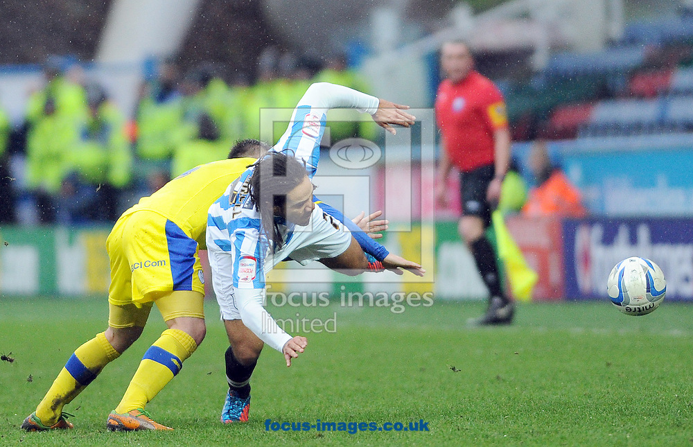 Picture by Graham Crowther/Focus Images Ltd +44 7763 140036.29/12/2012.Sean Scannell of Huddersfield Town is brought ndown by Rhys McCabe of Sheffield Wednesday during the npower Championship match at the John Smiths Stadium, Huddersfield.
