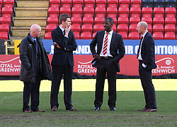 Charlton Athletic Manager, Chris Powell discusses the state of the pitch with the linesmen and fourth official - Photo mandatory by-line: Robin White/JMP - Tel: Mobile: 07966 386802 11/01/2014 - SPORT - FOOTBALL - The Valley - Charlton - Charlton Athletic v Barnsley - Sky Bet Championship