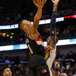 Mar 27, 2018; New Orleans, LA, USA; Portland Trail Blazers guard Damian Lillard (0) shoots over New Orleans Pelicans forward Cheick Diallo (13) during the second half at the Smoothie King Center. The Trail Blazers defeated the Pelicans 107-103. Mandatory Credit: Derick E. Hingle-USA TODAY Sports