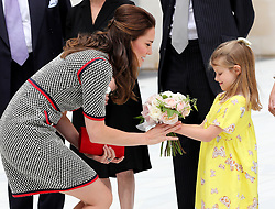 The Duchess of Cambridge receives a posy from Lydia Hunt, 6, during a visit to the Victoria and Albert Museum in London to officially open the Museum's new entrance, courtyard and exhibition gallery. <br />