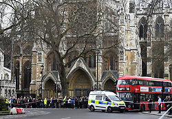 Police outside Westminster Abbey, London, after sounds similar to gunfire have been heard close to the Palace of Westminster. A man with a knife has been seen within the confines of the Palace, eyewitnesses said.