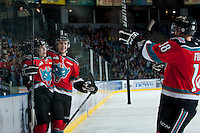 KELOWNA, CANADA - NOVEMBER 3:  Rourke Chartier #14, Jesse Lees #2 and Cody Fowlie #18 of the Kelowna Rockets celebrate a goal against the Prince George Cougars at the Kelowna Rockets on November 3, 2012 at Prospera Place in Kelowna, British Columbia, Canada (Photo by Marissa Baecker/Shoot the Breeze) *** Local Caption ***