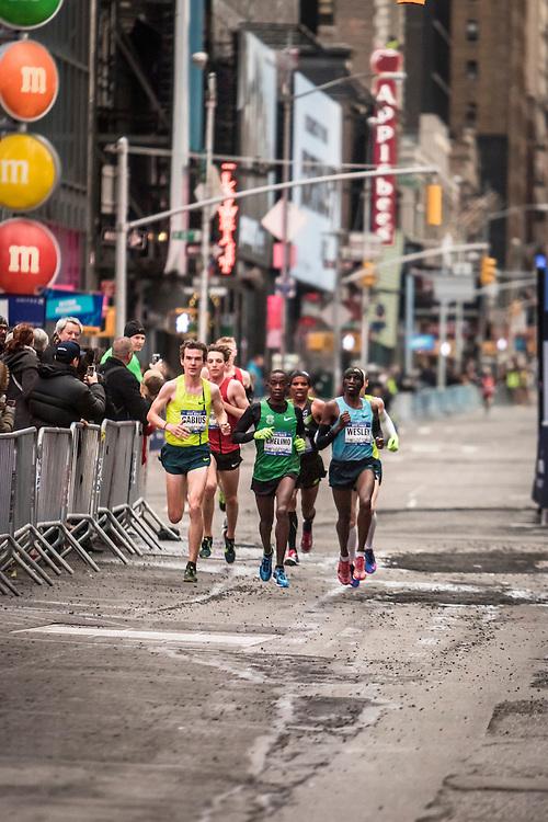lead pack of men race through Time Square, Sambu,  Barrios, Korir, April
