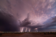 """The Storm Chaser<br /><br />Mike Olbinski went from photographing lightning in his backyard with a point-and-shoot camera to being a professional storm photographer—in a flash. His time-lapse storm videos have gone viral in a big way; one of them even made an appearance in a major motion picture. we spoke to Olbinski to find out how he does it.<br /><br /><br />Was storm photography how you started getting into photography?<br />I've always been a weather nut, and I would always write on Facebook that I should be a meteorologist, and why didn't I go to school for that, and all that kind of stuff. So I always liked that, and I just started looking at photography, and started following some guys who were doing lightning photography, and thought, """"that looks like so much fun."""" So I took this little camera out, and would just hold the shutter down, and it would just go click, click, click, and I would try to take pictures of lightning, and I got a few that were ok, and then one night I got an amazing one, and I couldn't believe it. Then I got on the local news, and I was hooked from there. I told my wife, """"I've got to get a camera that can do long exposures,"""" so we sold all of our DVDs on eBay for almost $500, and I bought a Canon Rebel and just started from there.<br /><br /><br />Do you remember the first storm photo that you sold?<br />Once I started getting into time lapses, that was when everything really took off for me, because selling prints is really hard, unless you're a name, and getting yourself a name takes time. People started licensing footage for stuff, and that's when I started making money. The latest big thing for me was this supercell I shot last June, in Texas, and it was just kind of rotating dust, and lots of colors, and that went viral. I didn't think that would happen to me again after my dust storm video in 2011, which went viral; that was a once-in-a-lifetime thing. But this was even bigger, and was actually the #1 time-lapse video on Vimeo la"""