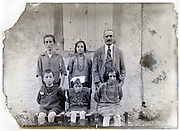 eroding glass plate with a family of four children posing
