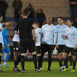 TELFORD COPYRIGHT MIKE SHERIDAN Telford players remonstrate with referee Richard Holmes as James McQuilkin of Telford is booked during the FA Trophy Round 1 fixture between AFC Telford United and Leamington at the New Bucks head Stadium on Tuesday, December 17, 2019.<br /> <br /> Picture credit: Mike Sheridan/Ultrapress<br /> <br /> MS201920-034