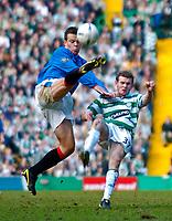 Photo. Jed Wee.Digitalsport<br /> Glasgow Celtic v Glasgow Rangers, Scottish FA Cup, Celtic Park, Glasgow. 07/03/2004.<br /> Rangers' Gavin Rae (L) and Celtic's Craig Beattie challenge for possession.