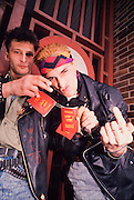 March 19, 1990. Bratislava, Czechoslovakia. Slovak punks showing their hated passports issued under Communist rule. (Photo Heimo Aga)