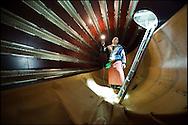 Un employe de chez Provins controle un pressoir à raisin, dans la cave de Sion en Valais / 2009.(PHOTO-GENIC.CH/ OLIVIER MAIRE)