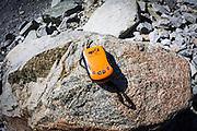 SPOT Messenger (personal communicator) on boulder, John Muir Wilderness, California