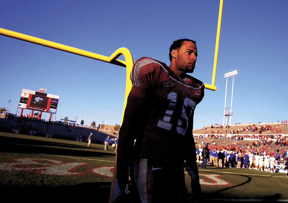 Xavier Mascareñas/New Mexico Daily Lobo; Dejected Lobo wide receiver Hank Baskett walks off the field at University Stadium after playing football for the last time in his college career. The Lobos lost the Nov. 19, 2005, game to Air Force 42-25.