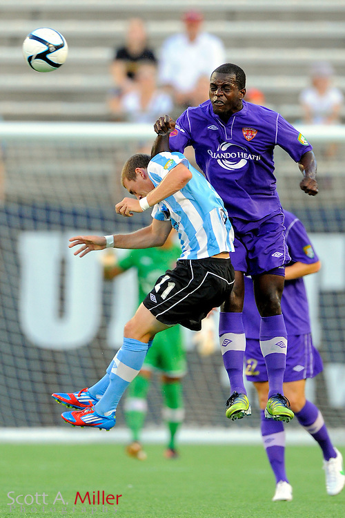 Orlando City Lions defender Kieron Bernard (5) and Wilmington Hammerheads forward Corey Hertzog (21) go airborne for a ball during their game at the Florida Citrus Bowl on July 25, 2012 in Orlando, Florida. ..©2012 Scott A. Miller