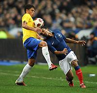 FOOTBALL - FRIENDLY GAME 2010/2011 - FRANCE v BRAZIL - 9/02/2011 - DANIEL ALVES (BRA) / FLORENT MALOUDA (FRA) - PHOTO FRANCK FAUGERE / DPPI