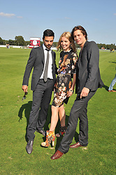 Left to right, DOMINIC COOPER, ANNABELLE WALLIS and JAMES ROUSSEAU at the Audi International Polo Day held at Guards Polo Club, Smith's Lawn, Windsor on 22nd July 2012.