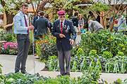 Darren Blanks, 30 Royal Hussars (L), on the Blind Veterans UK: its all about Community Garden by Andrew Fisher Tomlin and Dan Bowyer - The Hampton Court Flower Show, organised by the Royal Horticultural Society (RHS). In the grounds of the Hampton Court Palace, London.