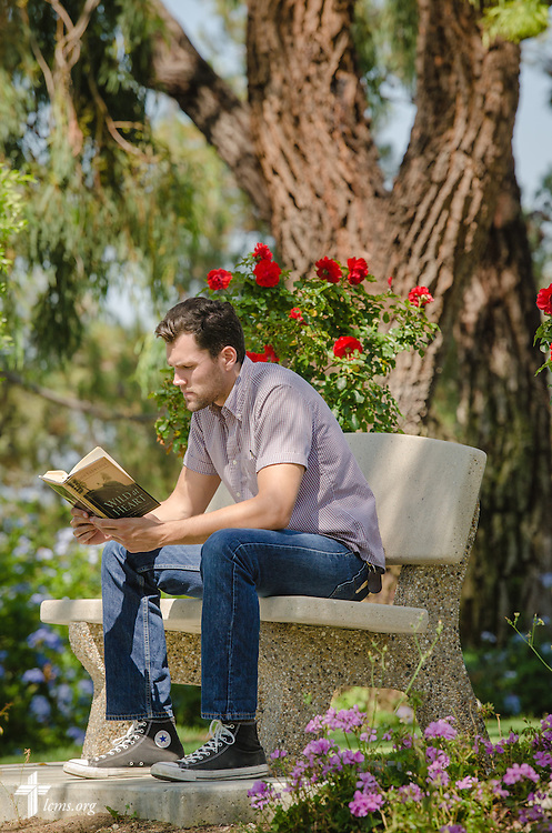 Alex Lange reads in the gardens next to Good Shepherd Chapel at Concordia University Irvine on Wednesday, July 9, 2014, in Irvine, Calif. LCMS Communications/Erik M. Lunsford