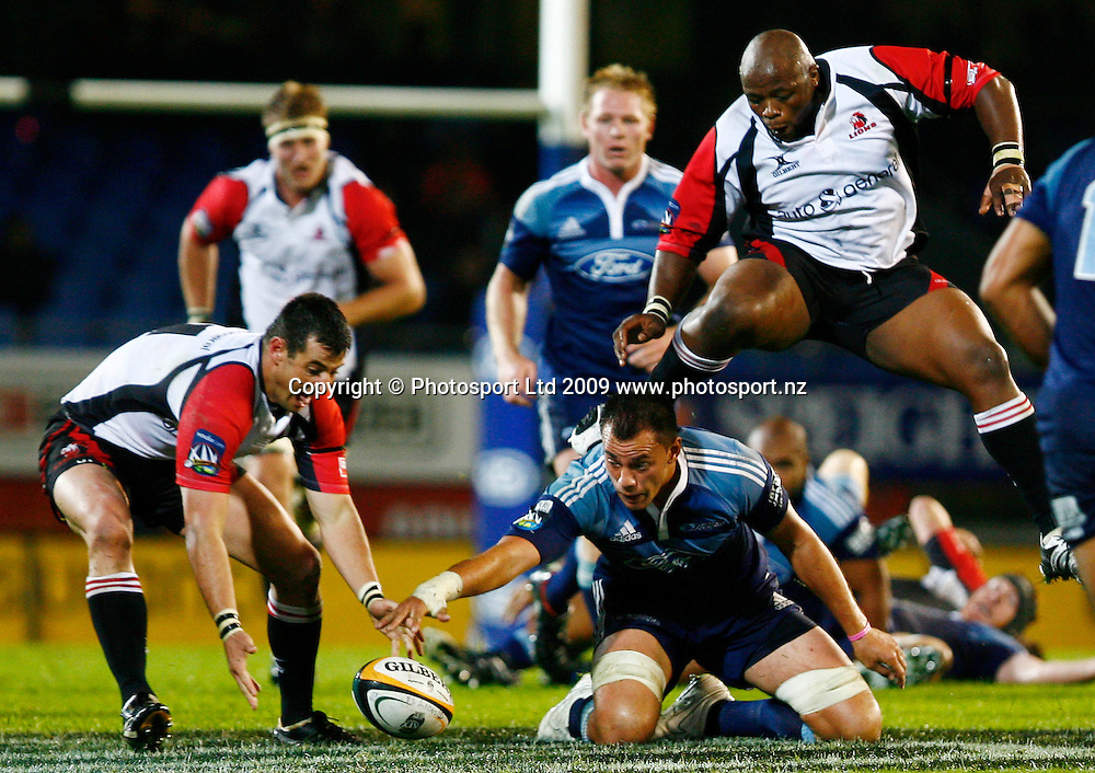 Blues Chris Lowrey competes for the ball against Lions Henno Mentz and Lawrence Sephaka during the Super 14 rugby union match, Blues v Lions at Eden Park, Auckland, New Zealand. Friday 10 April 2009. Photo: Anthony Au-Yeung/PHOTOSPORT