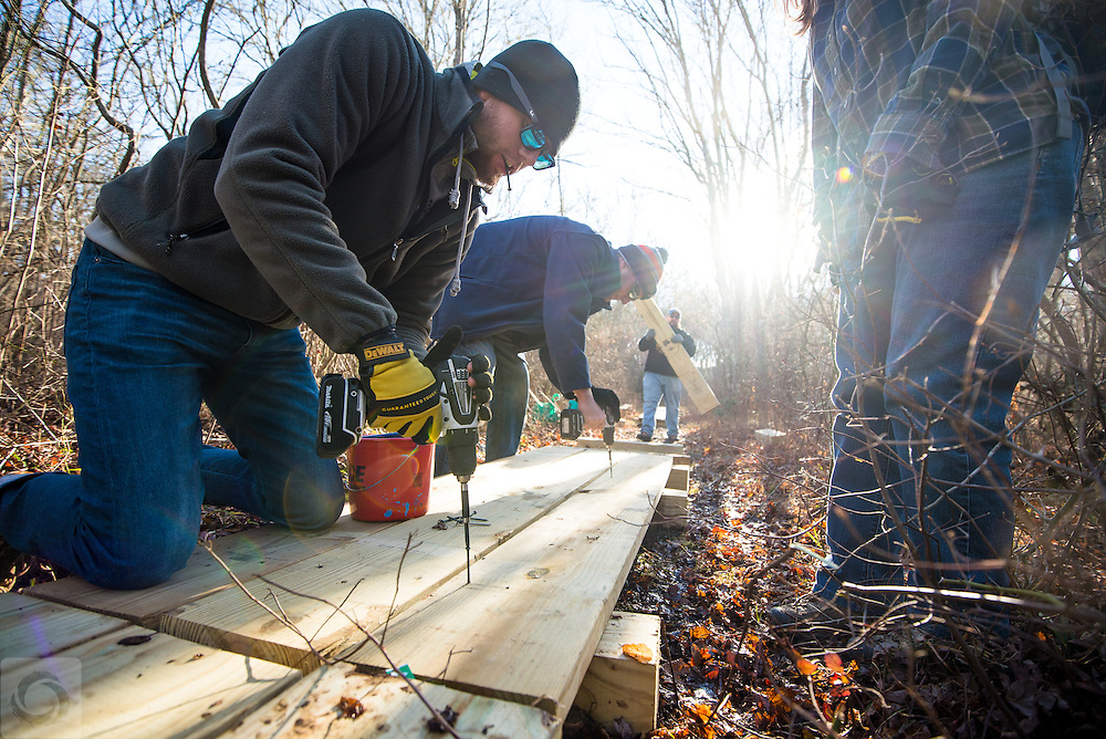 Environmental volunteers laying footpaths at the new Whitehead Nature Preserve for The Nature Conservancy.