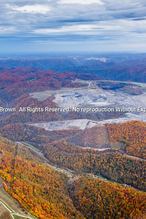 The Twilight surface mine looms above what was once the quiet, close-knit community of Lindytown. In order to expand operations, Massey Energy (now owned by Alpha Natural resources) pressured the community members to sell their homes and leave with the agreement that they wouldn't talk about the deal and that they would never return. Countless communities in Appalachia have been destroyed in this manner.