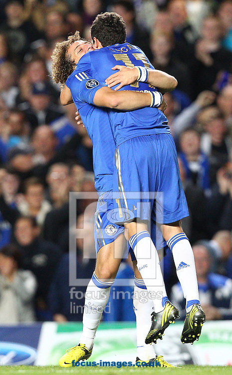 Picture by Paul Terry/Focus Images Ltd +44 7545 642257.19/09/2012.Oscar ( R ) of Chelsea celebrates with David Luiz after he scores the first goal during the UEFA Champions League match at Stamford Bridge, London.