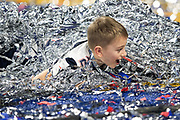 Garrett Hoyer, the son of New England Patriots quarterback Brian Hoyer (2), plays in a pile of confetti and streamers after the Patriots win the NFL Super Bowl 53 football game against the Los Angeles Rams on Sunday, Feb. 3, 2019, in Atlanta. The Patriots defeated the Rams 13-3. (©Paul Anthony Spinelli)
