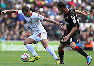 Picture by David Horn/Focus Images Ltd +44 7545 970036 29/09/2012.Charlie MacDonald of Milton Keynes Dons and Andy Bond of Crewe Alexandra during the npower League 1 match at stadium:mk, Milton Keynes.