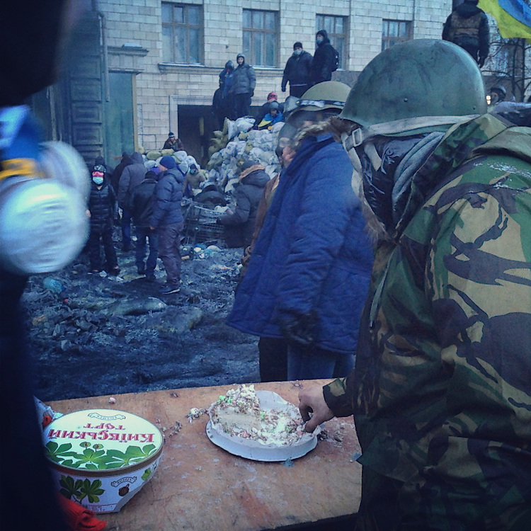 This is the kind of battle where you can eat cake on the front lines, Jan. 25, 2014. #euromaidan #ukraine #kyiv #євромайдан #київ #україна #primecollective