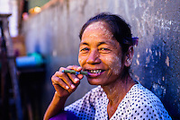 Woman smoking a cheroot, Anawrahta Street, the Indian Quarter, Yangon (Rangoon), Burma (Myanmar)