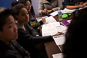 From left: Suzanne Sim, 18, Sydney Lewis, 17 and Denisse Abreu, 17, from the De Pauw Posse 11, debate viewpoints during a writing workshop at the Posse Foundation in New York, NY on April 01, 2014. Students in the Posse Foundation are chosen as scholars and go through college prep together as seniors in high school then attend the same college campus together where they get ongoing support. The Posse Foundation has identified, recruited and trained 5,544 public high school students with extraordinary academic and leadership potential to become Posse Scholars over the past 25 years.
