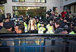 © London News Pictures. 19/12/2013 . TULISA CONTOSTAVLOS (centre)  leaving Westminster Magistrates court on London where she faced charges of supplying a class A drug. Former X-Factor judge Tulisa and Mike GLC (real name Michael Coombs)  are accused of supplying a class A drug to an investigative journalist. Photo credit : Ben Cawthra/LNP