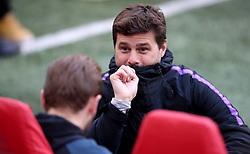 Tottenham Hotspur manager Mauricio Pochettino talks with Harry Kane during training