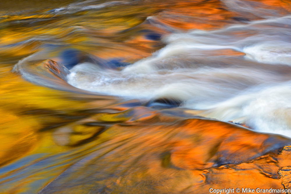 AUtumn colors reflected in Lower Rosseau Falls at sunset<br /> Rosseau<br /> Ontario<br /> Canada