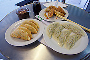 Vienna, Austria. Rochusmarkt. Mandu & Co. Deep fried Mandus with meat (backgr.), vegetables (l.) and steamed with meat.