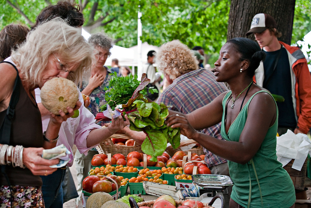 Selecting local foods at the Toronto's Dufferin Grove Organic Farmers' Market.