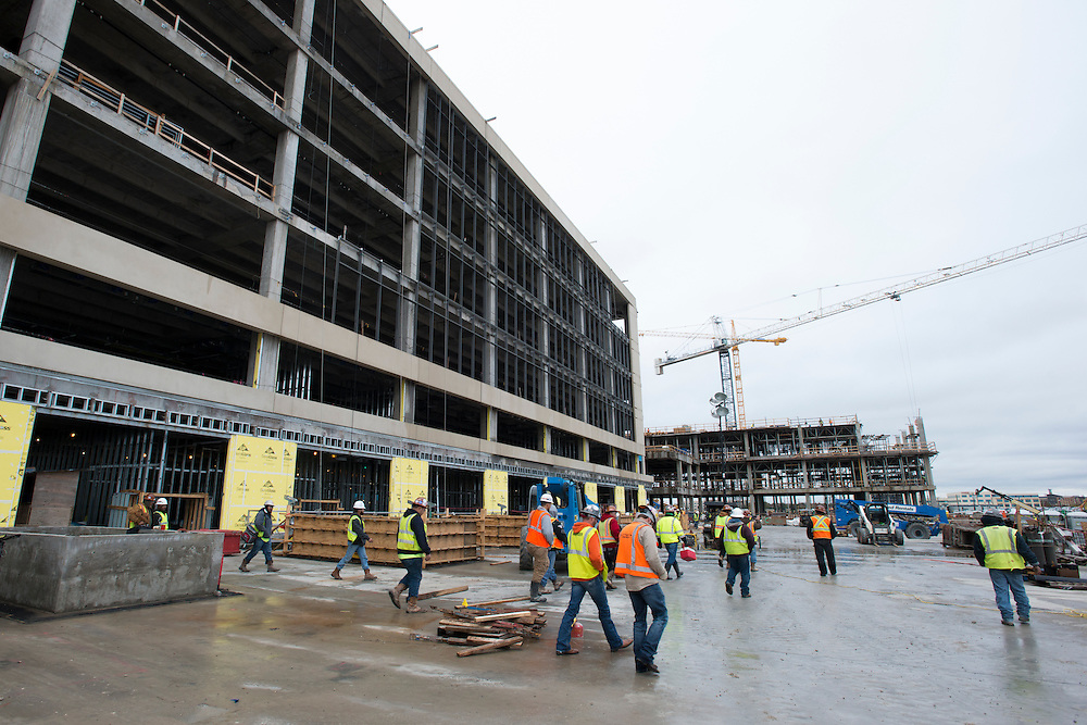 Construction workers take a lunch break at The Star, the new home of the Dallas Cowboys headquarters and practice facilities, in Frisco, Texas on November 30, 2015.  (Cooper Neill for The New York Times)
