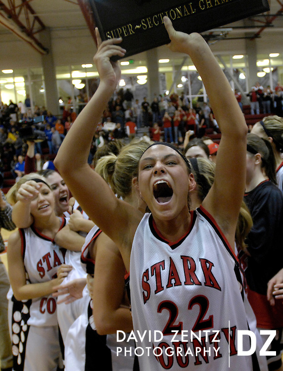 DAVID ZENTZ/JOURNAL STAR.Whitney Rumbold holds up the Super-Sectional Champs plaque to the crowd after helping lead the Stark County Lady Rebels to victory over the Princeton Tigresses at the 2007 Monmouth College Class A Super-Sectional in Monmouth Monday night. Stark held a commanding lead through most of the game, winning 54-40, and will now go on to the State Finals in Normal on Friday.